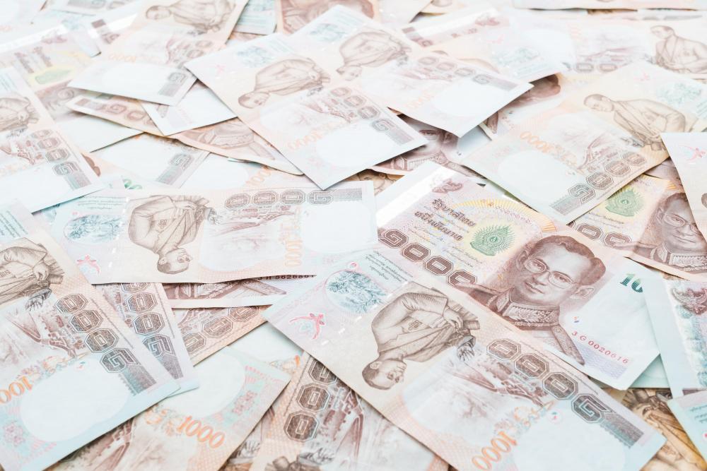 thai-banknote-cash.thumb.jpg.79343346e02d3e2314e06097ad112e89.jpg